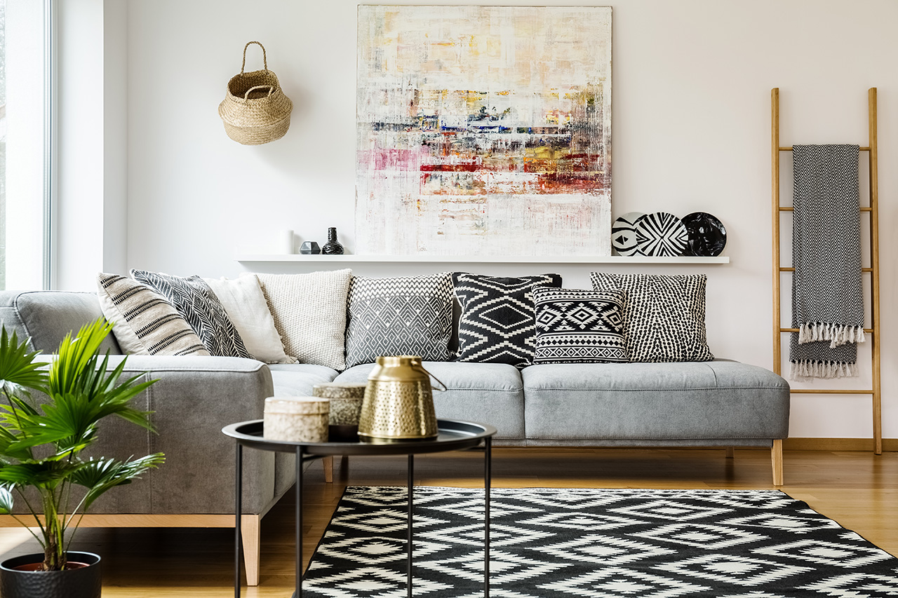 beautiful livingroom with couch and wall art